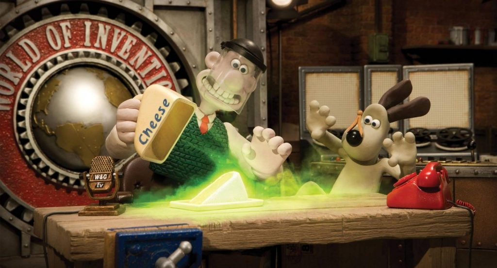 Wallace lifts the lid over a nuclear cheese as Gromit falls backwards