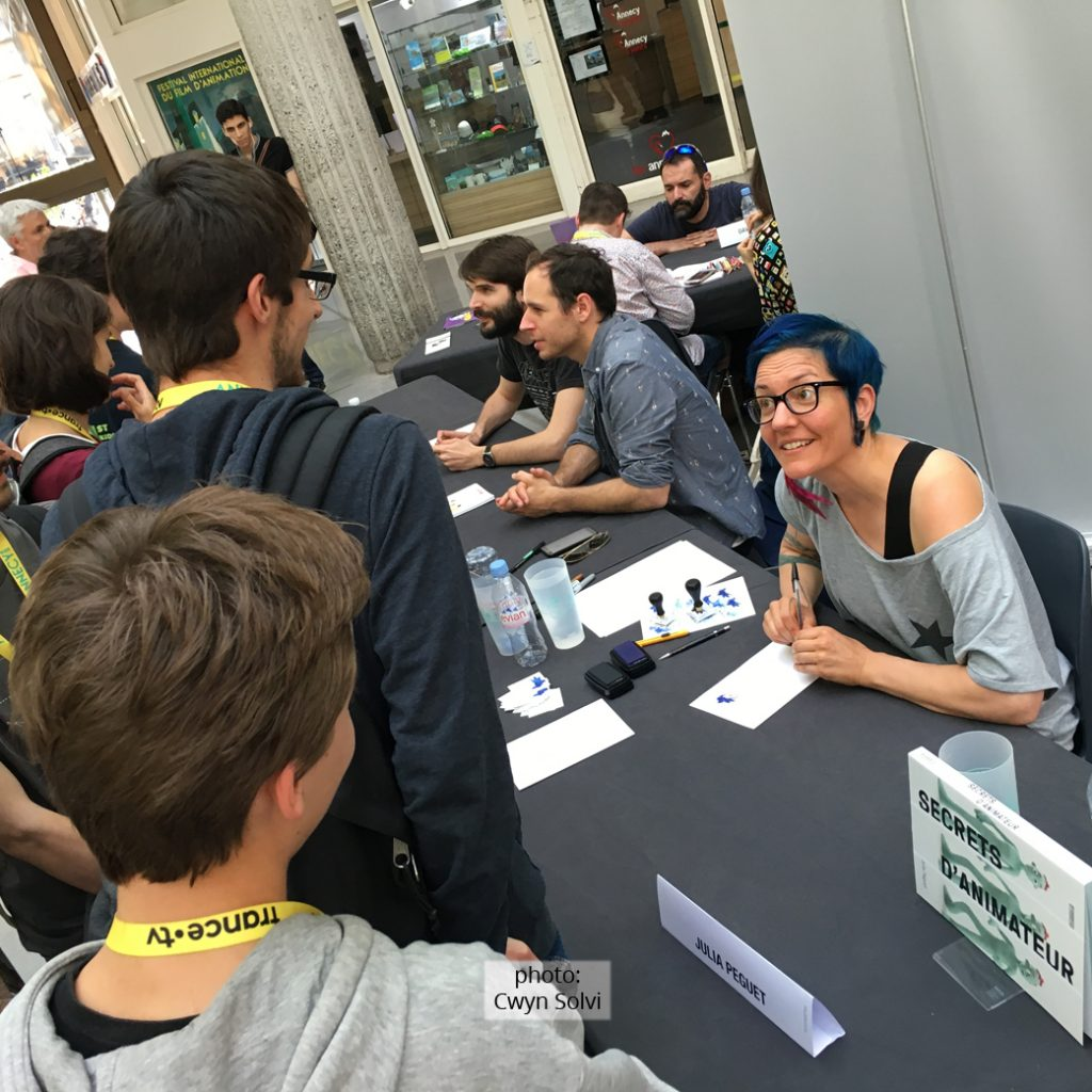 Julia Peguet signing her book at Annecy Animation festival